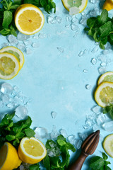 Fresh mint and lemons for making lemonade or cocktail. Top view with copy space.