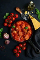 Spicy meatballs in tomato sauce. Top view with copy space.