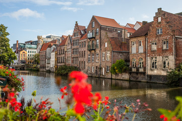 Vibrant street view of downtown Ghent, capital city of east Flanders province, Belgium along Leie river Fototapete
