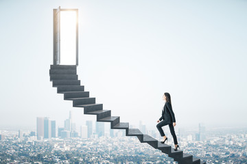 Businesswoman walking on ladder to success megapolis city view Wall mural