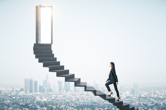 Businesswoman walking on ladder to success megapolis city view