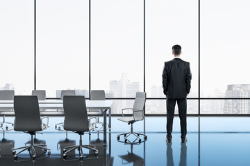 Businessman standing in meeting room
