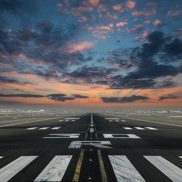 airport runway with beautiful cloudy sky