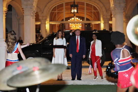 U.S. President Donald Trump views the Marching Band performance in Florida