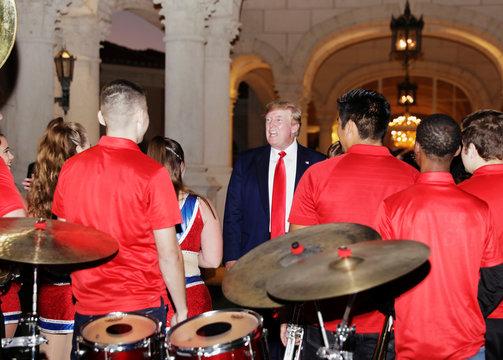 U.S. President Donald Trump views the Florida Atlantic University Marching Band performance in Florida