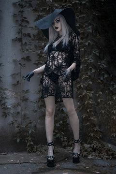 Dark beautiful gothic enchantress standing outdoor