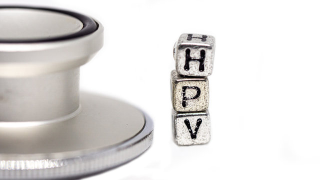 """Stethoscope with   text """" HPV""""  put on white background. Concept Prevent HPV infection by vaccination before getting infected."""