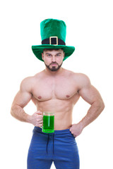 St. Patrick's day. A muscular man in a green hat holds a mug of ale and beer. Isolated white...