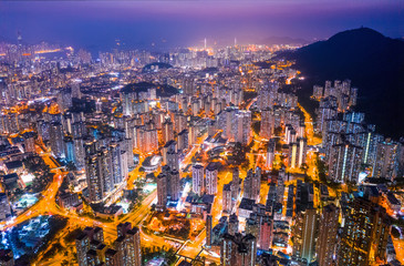 Fototapete - Night of Kowloon district, under the lion rock mountain, Hong Kong, cityscape