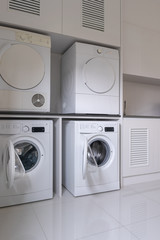 Laundry washing machine and dryer against  modern appliance household in laundry