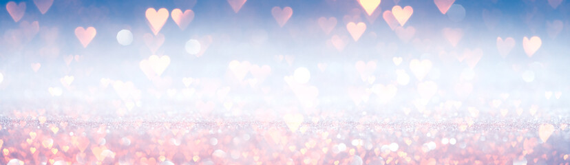 Romantic wallpaper. Sparkling pink hearts on shiny silver and blue background. For love, romance,...