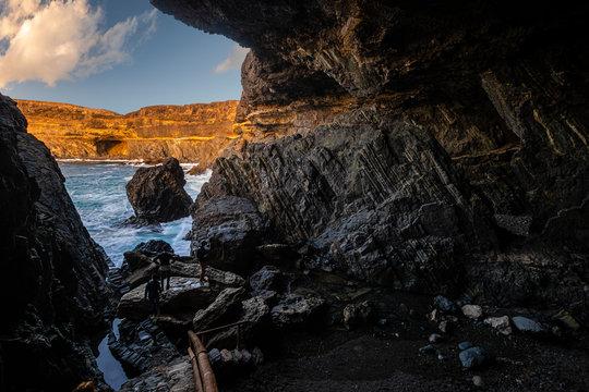 Caves at the ocean cliff in Monumento Natural de las Cuevas de Ajuy National Park