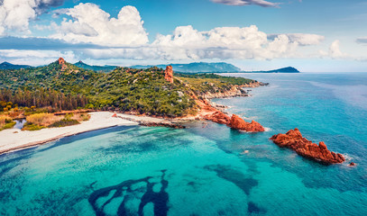 Deurstickers Mediterraans Europa View from flying drone. Wonderful summer view of di Cea beach with Red Rocks Gli Scogli Rossi - Faraglioni. Aerial morning scene of Sardinia island, Italy, Europe.