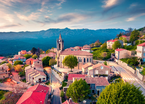 View from flying drone. Astonishing evening cityscape of Zonza town, commune in the Corse-du-Sud department of France. Fantastic sunset on Corsica island, France, Europe.
