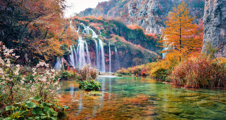 Gorgeous morning view of pure water waterfall in Plitvice National Park. Stunning autumn afternoon in Croatia, Europe. Abandoned places of Plitvice lakes series. Beauty of nature concept background.