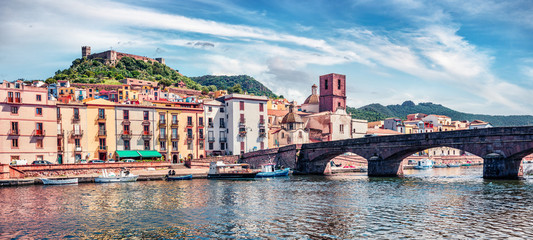 In de dag Schip Panoramic spring cityscape of Bosa town with Ponte Vecchio bridge across the Temo river. Amazing morning view of Sardinia island, Italy, Europe. Traveling concept background.