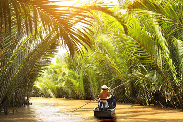 People boating in the delta of Mekong river, Vietnam
