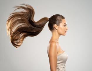 Keuken foto achterwand Kapsalon Profile portrait of a beautiful woman with a long straight hair.