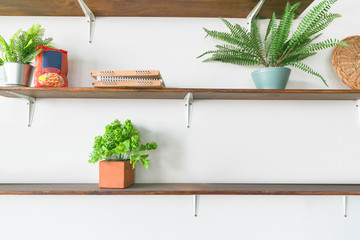 Wooden shelf of free space with white wall background in home interior. Copy space.