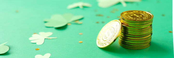 St. Patrick's day, clover and gold coins on a green background