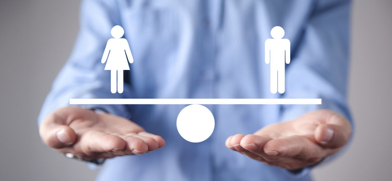 Man showing balance scale. Man and Woman equality