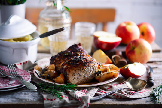 Roasted pork loin with apples.style rustic