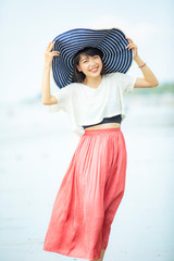 beautiful asian younger woman smiling with happiness on vacation sea beach