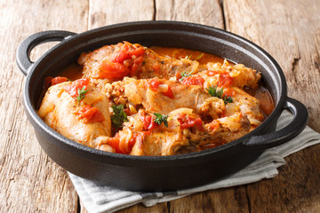 Tasty spicy rabbit stew in tomato sauce with white wine and herbs close-up in a pan. horizontal