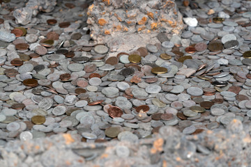 pompei ruins houses full of tourist coins