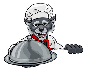 A wolf chef mascot cartoon character holding a silver platter cloche dome of food peeking round a sign