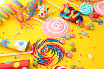 candies with jelly and sugar and streamers. colorful array of different childs sweets and treats. Fotoväggar