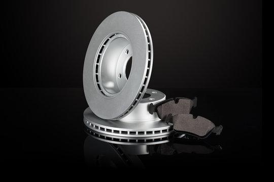 Car or automotive brake disc on black background