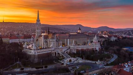 Budapest, Hungary - Beautiful dramatic golden sunset behind the famous Fisherman's Bastion (Halaszbastya) and Matthias Church on a winter afternoon