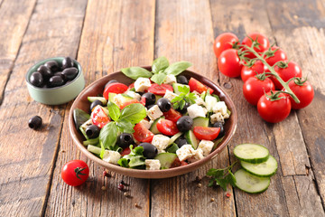 Wall Mural - vegetable salad with feta cheese, cucumber, tomato and basil