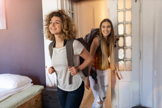 Young female tourists staying in youth hostel