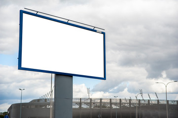Blank white advertising billboard in front of sport stadium