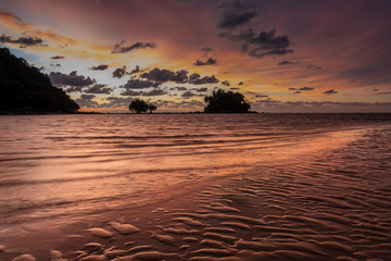 A stunning atmospheric sunset on the beach in Phuket