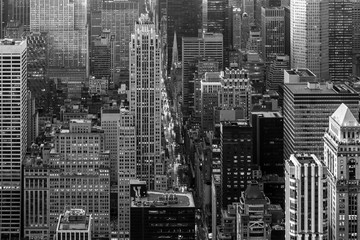 Fototapete - Aerial view of New York City skyline with 5th Avenue at Manhattan midtown. Urban skyscrapers at dramatic after the storm sunset, USA. Black and white image.
