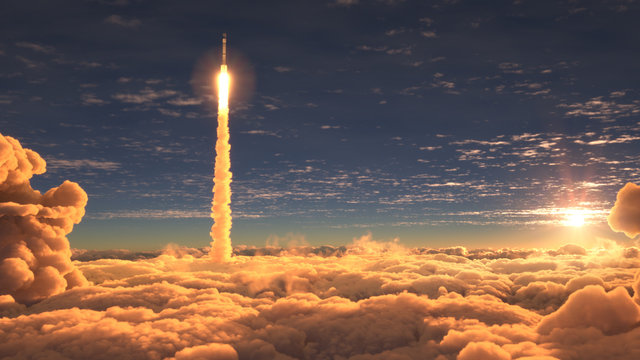 Rocket flies through the clouds at sunset