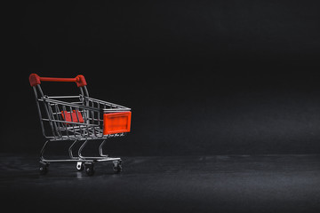 Shopping cart on dark background, business, shopping concept. Selective focus