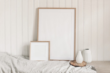 Portrait and square empty wooden frame mockups with linen cloth and modern ceramic vases. White beadboard wainscot wall paneling background. Scandinavian interior, home design. Art concept. Wall mural