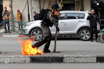 An Israeli border policeman is on fire as he is hit with a molotov cocktail thrown by Palestinian demonstrators during a protest against the U.S. President Donald Trump's Middle East peace plan, in Hebron in the Israeli-occupied West Bank