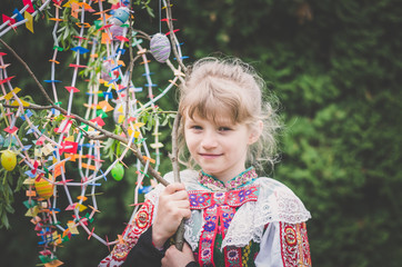 Happy easter compliment from girl in national folk costume