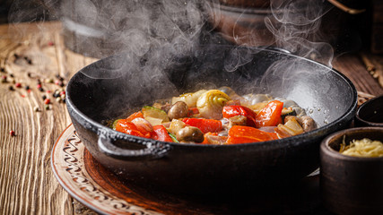 European cuisine in Ukrainian style. Warm grilled vegetable salad with beer in smoke. Serving meals in a rustic restaurant. background image, copy space text
