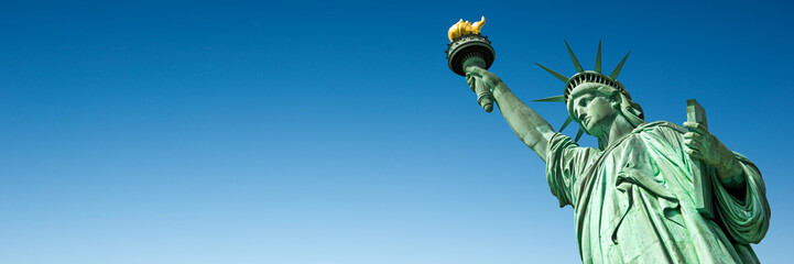 Statue of Liberty in New York, USA. Blue sky panoramic background with copy space Fotobehang