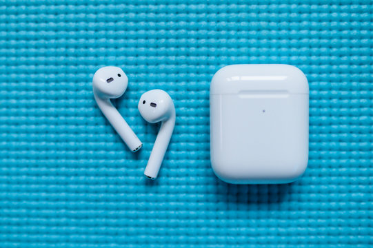 SAN FRANCISCO, USA - FEBRUARY 3, 2020: Apple AirPods Pro, blue background, wireless Bluetooth earbuds created by Apple.