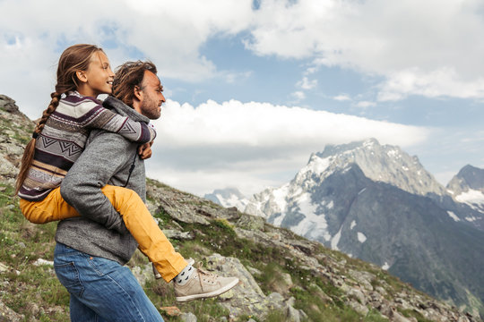 Father with child walking on the mountain and enjoying beautiful view