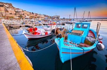 Poster Oost Europa Seaside city of Kavala in Greece. Coloful evening scene, eastern Macedonia, Europe. Greek fishing boats. View on dock for boats and yachts in a beautiful spring evening.