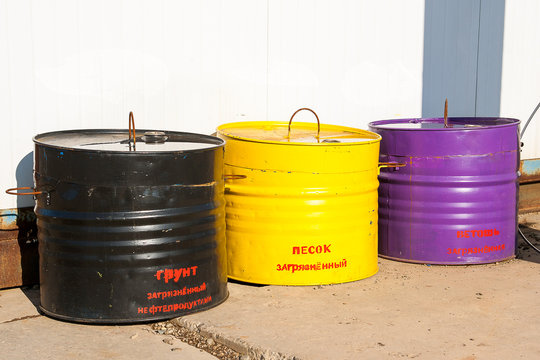 Tanks with inscriptions:  oil contaminated soil, contaminated sand, contaminated rags