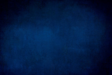 Dark blue grungy backdrop or texture Fotomurales